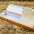 Stock Photo: Close up of vintage wooden casket on wooden background