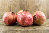 Pomegranate isolated on wooden background — Foto de Stock