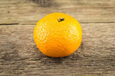 Ripe tangerines on wooden background — Stok fotoğraf