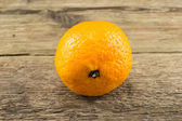 Ripe tangerines on wooden background — Foto de Stock