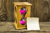 Hourglass with space for text on the wooden background — Stock Photo