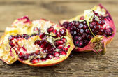 Pomegranate isolated on wooden background — Stock fotografie
