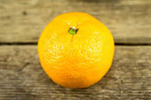 Ripe tangerines on wooden background — ストック写真
