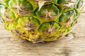 Pineapples on wooden grunge background — Stock fotografie