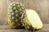 Pineapples on wooden grunge background — Stockfoto