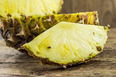 Pineapples on wooden grunge background — Stock Photo