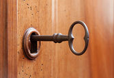 Old key in a keyhole — Stock Photo