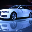 White Audi A4 sedan on display in a car sales shop, Tangshan, Ch — Stock Photo #30837433