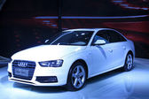 White Audi A4 sedan on display in a car sales shop, Tangshan, Ch — Stock Photo