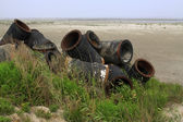 Nevyužité objekty, zvířený písek potrubí — Stock fotografie