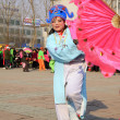 Stock Photo: People wear colorful clothes, yangko dance performances in s