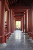 Antique building red column — Stock Photo