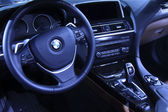 BMW motor steering wheel in a car sales shop — Stock Photo