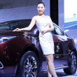 Luxury cars and beautiful female model on display in TangShan, C — Stok fotoğraf