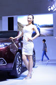 Luxury cars and beautiful female model on display in TangShan, C — Stock Photo