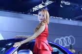 Beautiful female model in a car exhibition, China — Stock fotografie