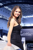 Beautiful Russia female model in a car exhibition, China — Stock Photo