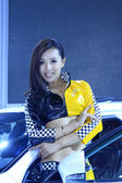 Beautiful female model in a car exhibition, China — Stock Photo