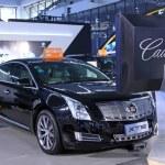 Постер, плакат: Cadillac XTS luxury car on display in a car sales shop Tangshan