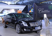 Cadillac XTS luxury car on display in a car sales shop, Tangshan — Stock Photo