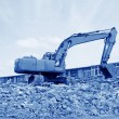 Excavator cleaning construction waste — Stock Photo