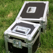 Silver tin box on a green lawn — Stock Photo