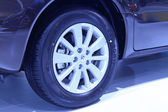 Car wheels in a car sales shop — Stock Photo