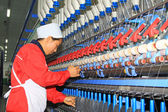 A worker was nervous operation in spinning workshop — Stock Photo