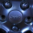 Stock Photo: Jeep off road vehicle wheels