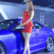 Luxury cars and beautiful female model on display in TangShan, C — ストック写真
