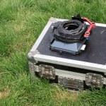 Silver tin box on a green lawn — Stock Photo #33709665