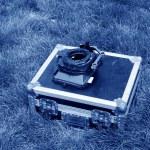 Silver tin box on a green lawn — Stock Photo #33719673