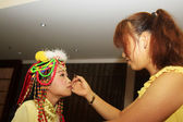 Make-up artist giving the little actor makeup — Stock Photo