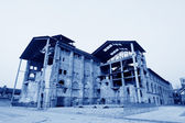 Dilapidated building in a factory — Stock Photo