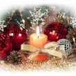 Christmas still life with candle, Christmas decorations and pine cones in a white frame — Stock Photo