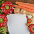 Stock Photo: Grocery shopping list with notebook and fresh vegetables