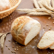 Rustic table with fresh bread — Stockfoto