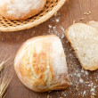 Rustic table with fresh bread — Foto Stock