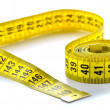 Whirled yellow tape measure — Stock Photo