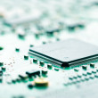 Computer chip and circuit board — Stock Photo #28218273