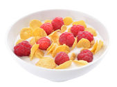 Corn flakes and raspberries with yogurt — Stock Photo