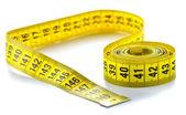 Medida de fita amarela rodopiou — Foto Stock