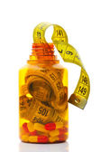 Close up of measuring tape in a pills bottle — Stock Photo