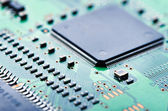 Computer chip and circuit board — Stock Photo