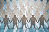 Rows of paper cut figures — Stock Photo