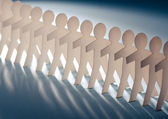 Row of paper cut figures — Stock Photo