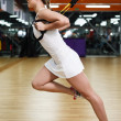 Young attractive woman does suspension training with fitness straps — ストック写真