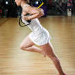 Young attractive woman does suspension training with fitness straps — 图库照片