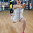 Woman does suspension training with fitness straps  — Stok fotoğraf