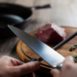 Man sharpening the knife — Stock Photo